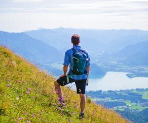 Hiker with a view of the landscape in the Salzkammergut