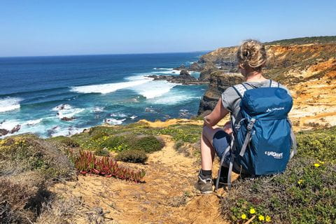 Hiking break with view to the wild coastline of the Rota Vicentina