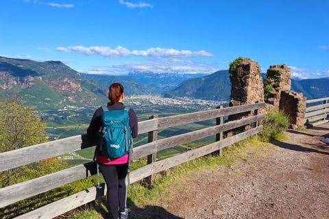 Hiker looks out over Bolzano and the Dolomites