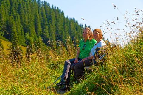Hikers enjoy the break amidst the beautiful landscape