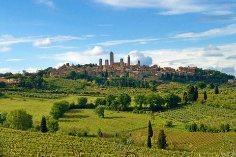 Hiking in Tuscany overlooking San Gimignano