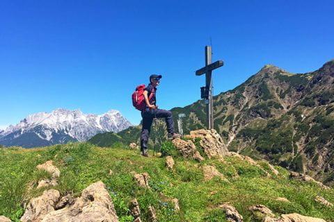 Hiker on a peak of the Kitzbuehel Alps