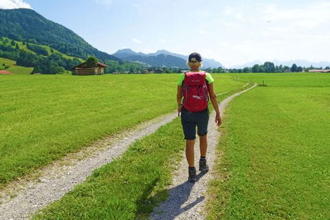 Hiker on the hiking trail from Munich to Garmisch