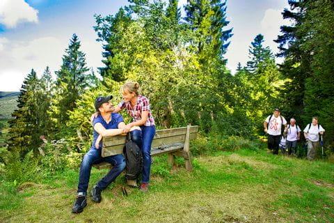 Enjoying the hiking break on a bench