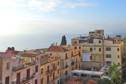 Panoramic view at the houses and the sea of Taormina
