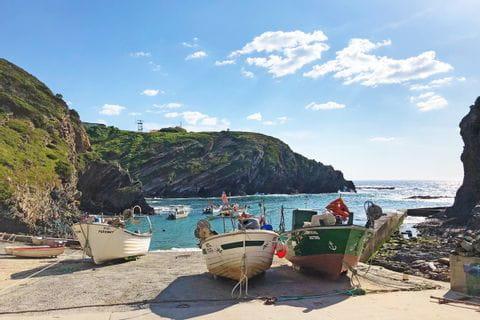 Colourful fishing boats while hiking along the Alentejo coast