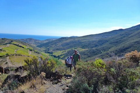 Hiker without luggage on hiking tour from Collioure to Cadaquès
