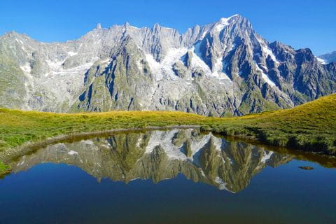 Mountain lake with view to the French Alps
