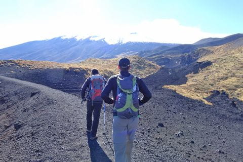 Unspoilt hiking paths along the black lava fields of mount Etna