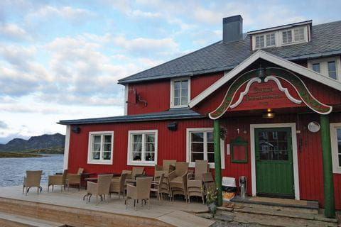 Nice restaurant at the mountain lake invites you to take a break