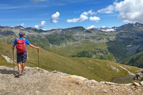 Hiker in Gastein with a stunning view of the surrounding mountain landscape