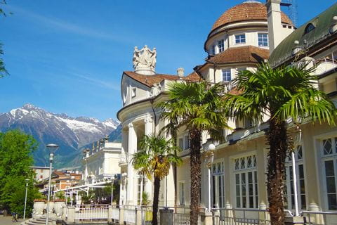 Walking path leads along the well-known Kurhaus in Merano