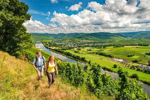 Hiker with a fantastic panoramic view on the Mosel