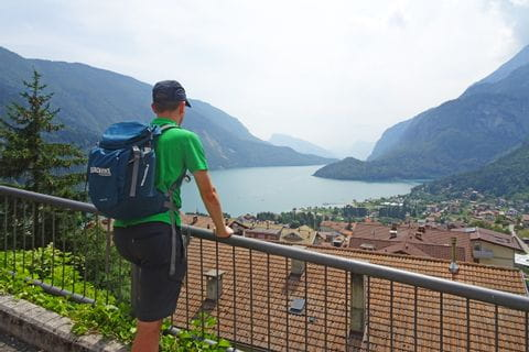 Hiker enjoys the view of the Molveno Lake