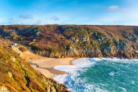 The beach of Porthcurno at sunset