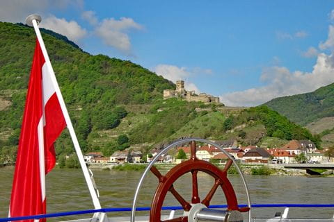 Boat cruise on the Danube with view of a ruin