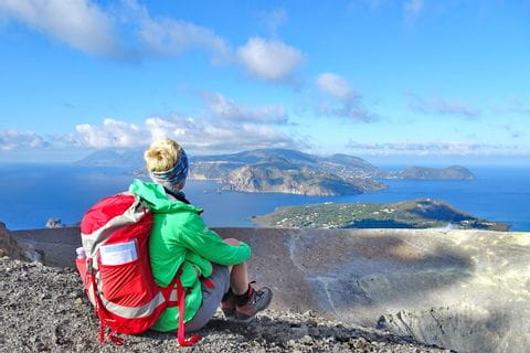 Hiking break with seaview from the edge of the volcanic crater of Vulcano