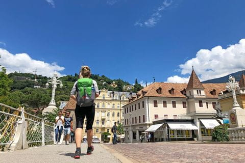 Hikers explore the cure town Meran