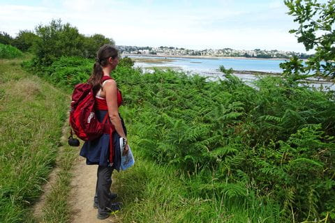 Hiker enjoy the beautiful view from the coastal path