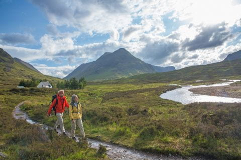Walkers explore the picturesque landscape of Glen Coe