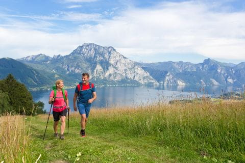 Hikers in front of the lake panorama at Lake Traunsee