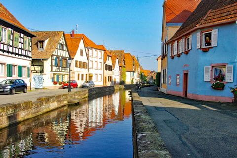 French cultural village with stream along the hiking tour