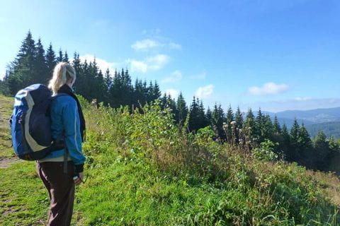Hiker enjoys the mountain panorama