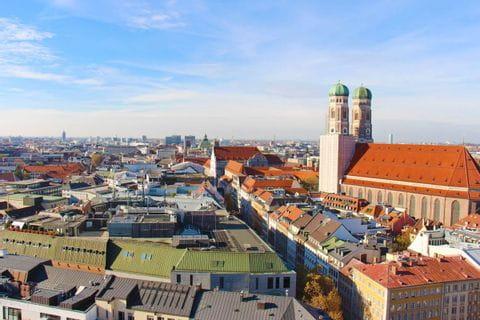 Hiking start from Munich to Garmisch with a view of the church Frauenkirche