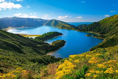 Hiking at lake Lagoa do Fogo on Azores island