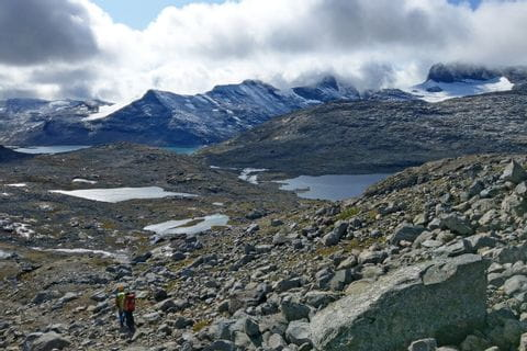 Rocky hiking trails to the mountain lakes in Jotunheimen National Park