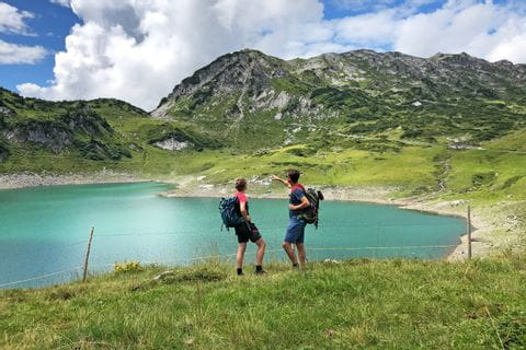 Hikers at the Formarinsee lake in Lech am Arlberg