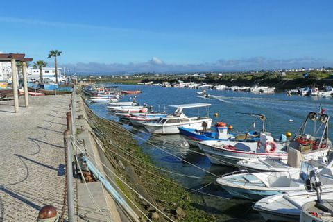 Small harbour at the coastal area of the Algarve region