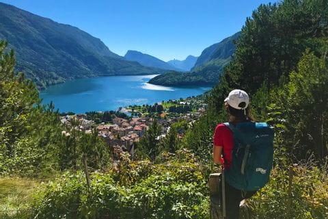 Hiker looks out over the magnificent Molveno Lake