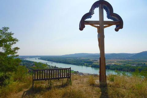 Hiking rest at the summit cross with Danube panorama