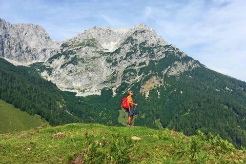 Hiker in front of Wilder Kaiser mountain