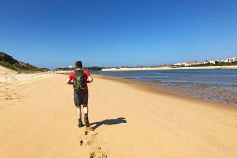 Walking through the sandy dunes along Rota Vicentina