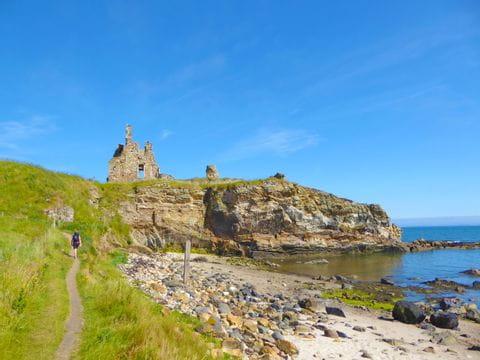 Hiker along the coast in Scotland