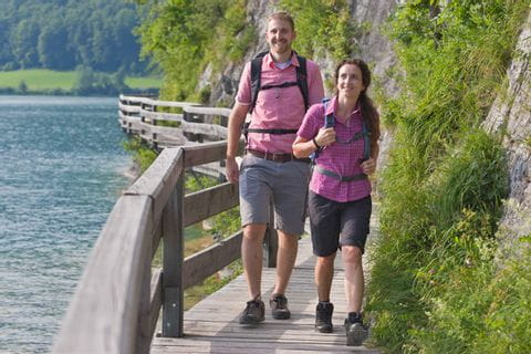 Hikers along the lake trail towards St. Gilgen at lake Wolfgangsee