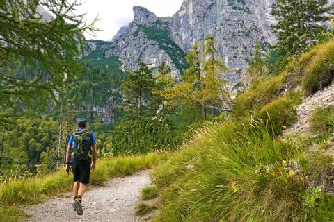Hikers marvel at the impressive mountain scenery of the Brenta Dolomites