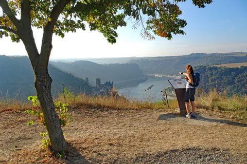 Hiker with view onto castle Katz