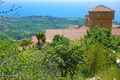 A castle surrounded by green nature in Cilento