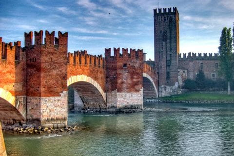 Hiking overlooking the imposing Ponte Scaligero in Verona