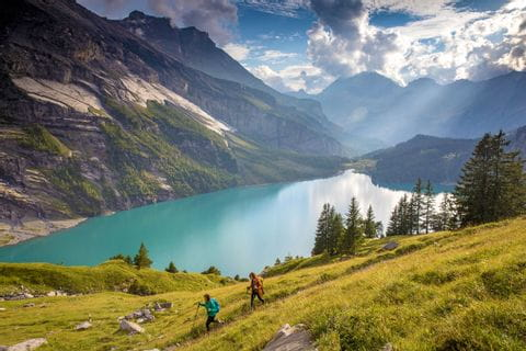 Hikers on Lake Oeschinen with a fantastic view