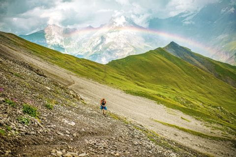 Hiking on the Alpschelegrat with a rainbow over Kandersteg