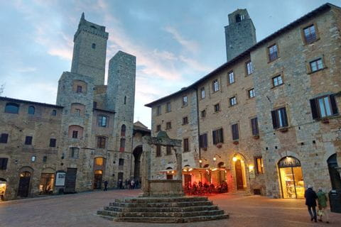 The fountain square in San Gimignano at the evening hour