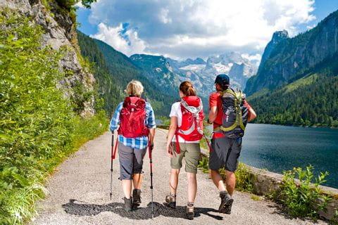Hiking group at beautiful lake Gosausee